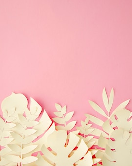 Tropical leaves in paper cut style in pink