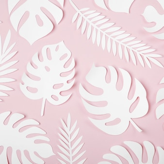 Tropical leaves pattern. various paper leaves on pastel background. paper art.