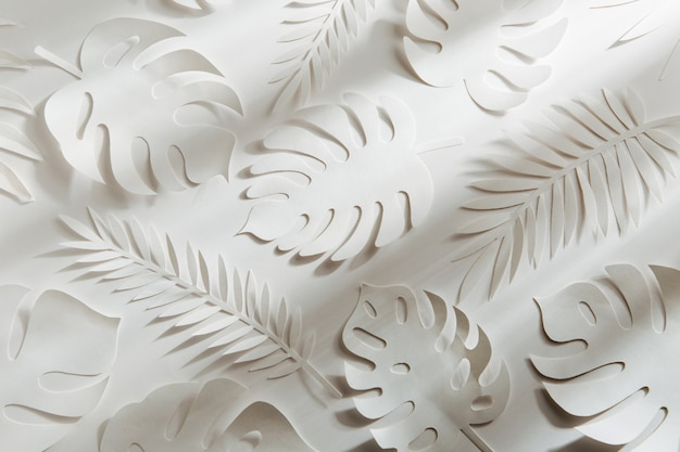 Tropical leaves pattern. various paper leaves on white background. paper art. flat lay, top view