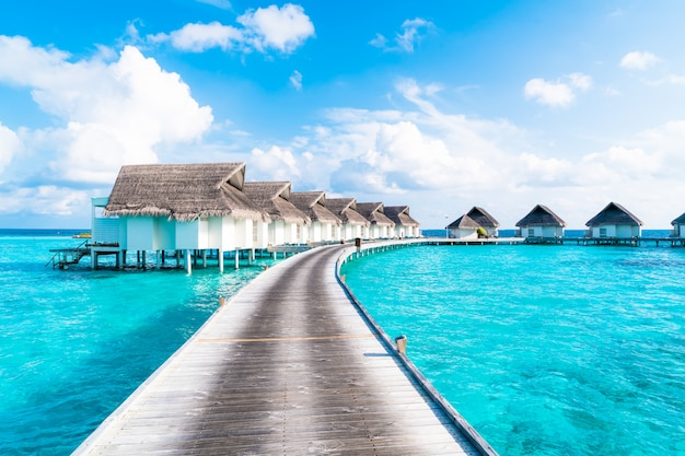 Tropical maldives resort hotel and island with beach and sea for holiday vacation concept