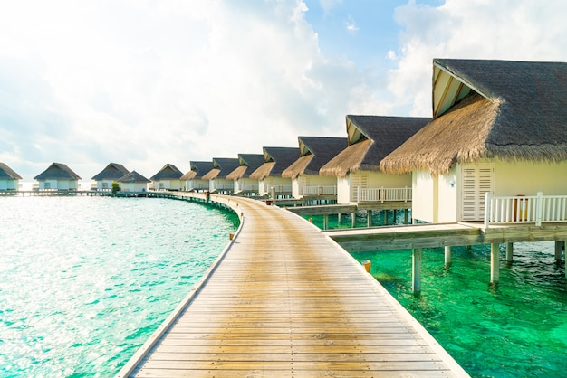 Tropical maldives resort hotel and island with beach and sea