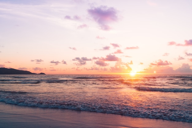 Tropical nature sea or beach in summer time with sunrise or sunset with light flare.