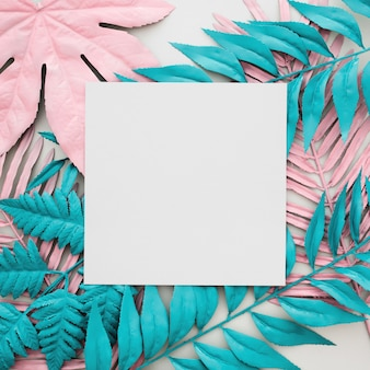 Tropical palm leaves, white paper blank on white background