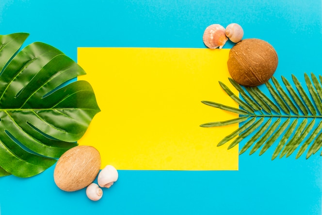 Tropical palm leaves on yellow and blue background
