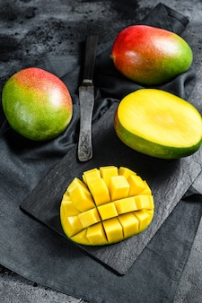 Tropical ripe mango fruit. black background.
