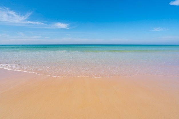 Tropical sandy beach with blue ocean and clear blue sky background image for nature background or summer background amazing beach in phuket thailand.