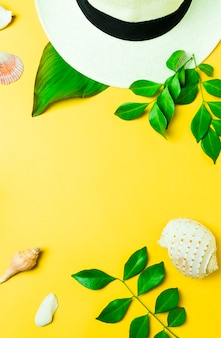Tropical summer concept with hat and seashell