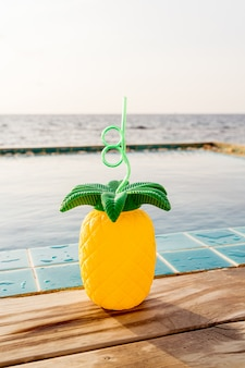 Tropical summer drinks beside the swimming pool