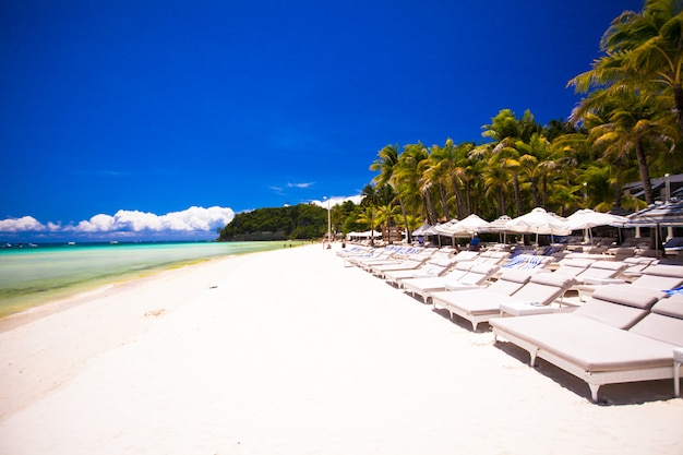 Tropical white sunny beach in beautiful exotic resort