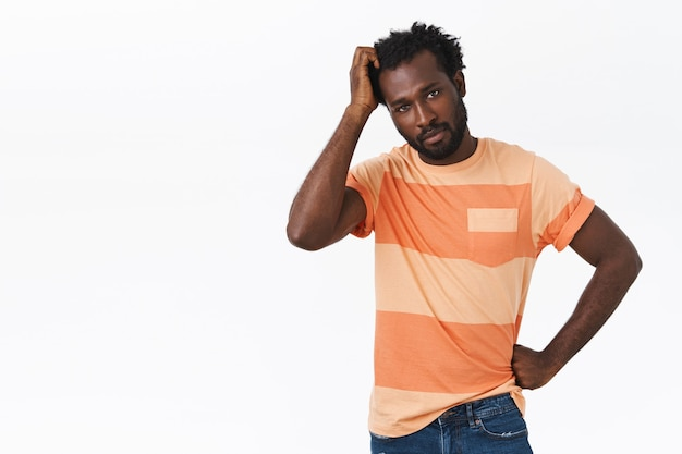 Troubled and unsure pretty african-american bearded guy have no idea how thing works