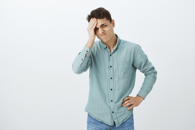 Troubled upset young man in casual shirt