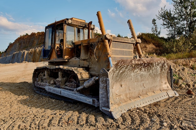 Truck digging ground for construction excavator gravel sand trees blue sky