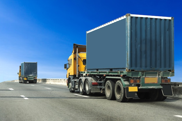 Truck on highway road with blue container, import, export logistic transport