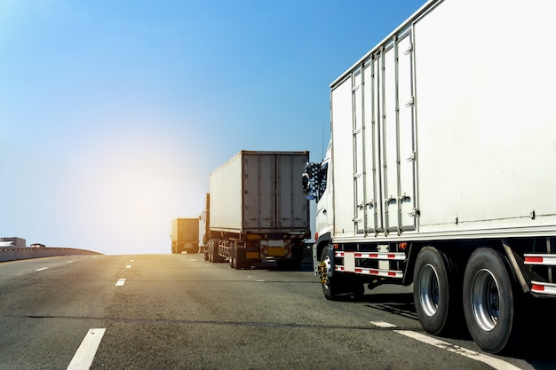 Truck on highway road with container,logistic industrial with blue sky