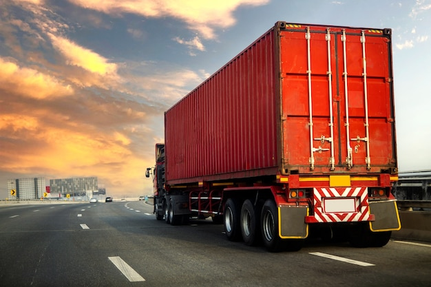 Truck on highway road with red container, transportation concept.,import,export logistic industrial transporting