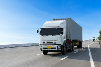 Truck on highway road with container, import, export logistic transport