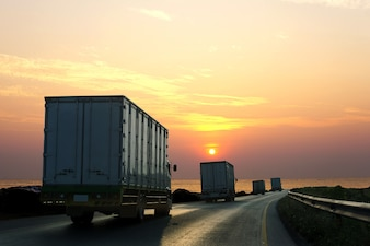 Truck on highway road with container