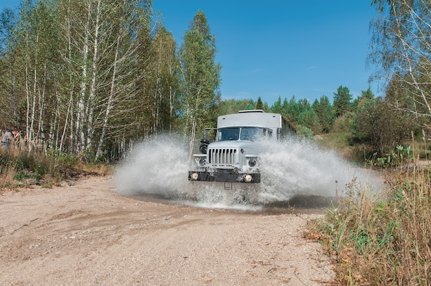 Truck passes through a puddle