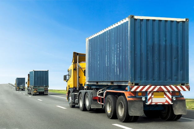 Truck on road with blue container, transport on the expressway