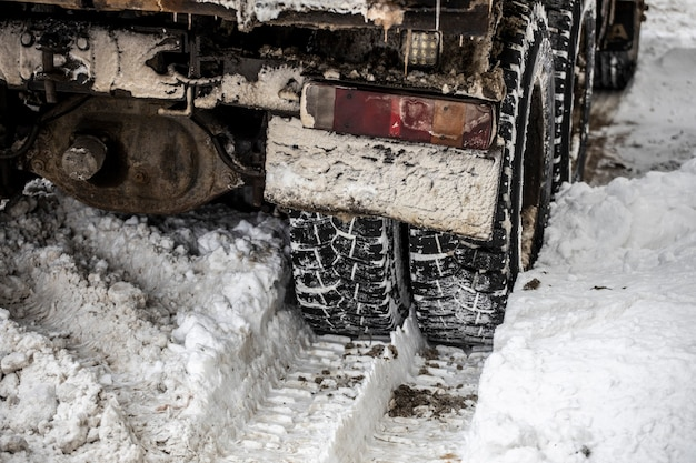 Truck in the snow view from behind. high quality photo
