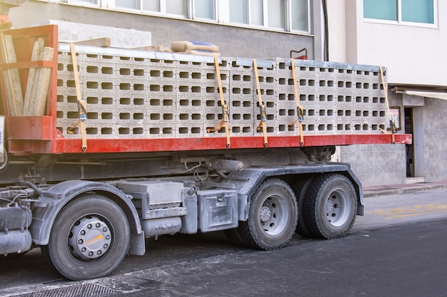 Truck with a fully loaded body of concrete blocks with cement.