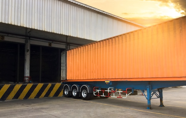 The trucks container docking load cargo at warehouse, freight industry logistics transport