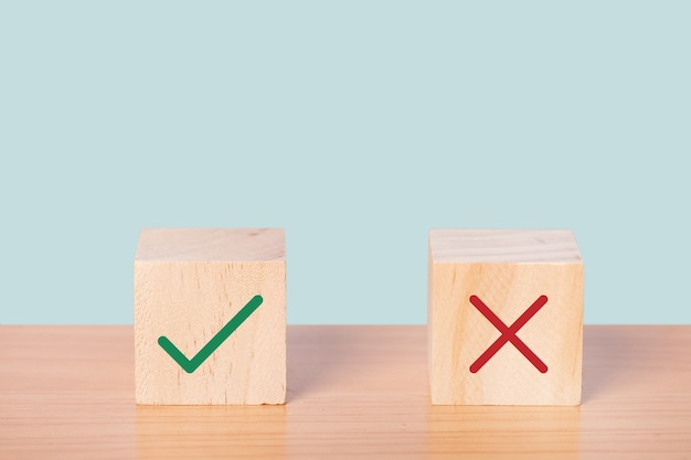 True and false symbols accepted rejected, yes or no on wood cubes.
