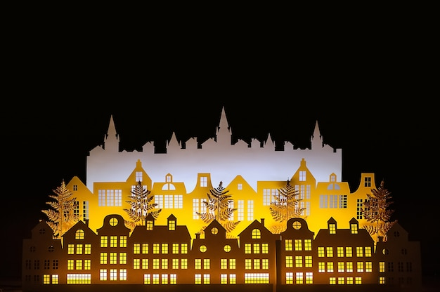True paper art night winter gold town with new year lights. merry christmas.