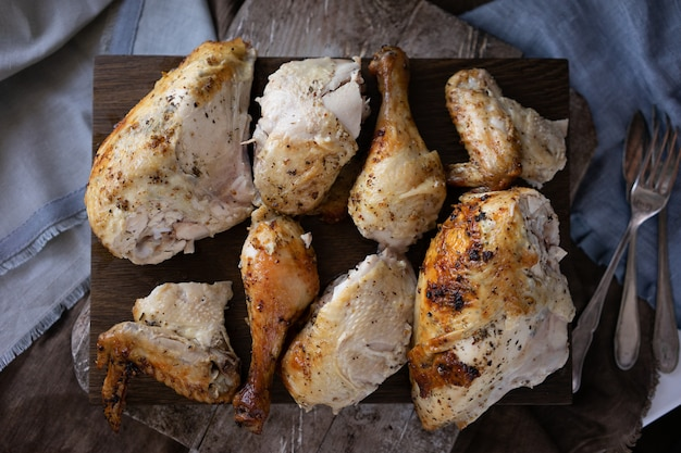True pieces of chicken on a wooden chopping board