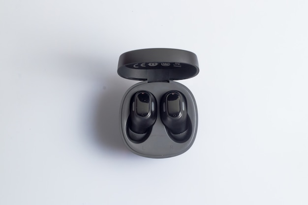 True wireless stereo earbuds in black on a white background