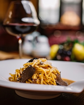 Truffle spaghetti plate with mushroom sauce and grated parmesan