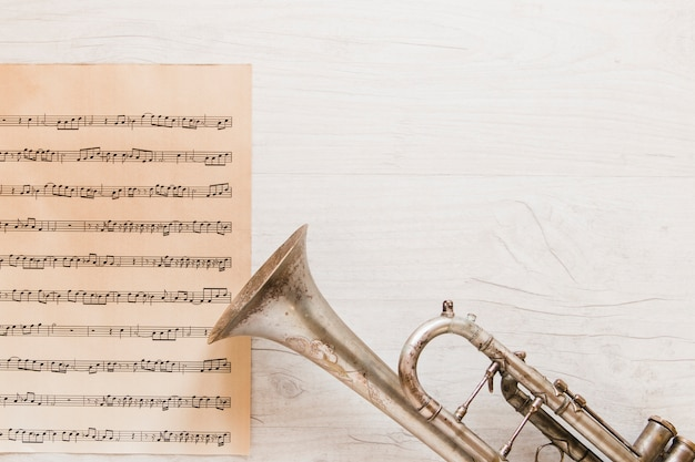 Trumpet near page of sheet music