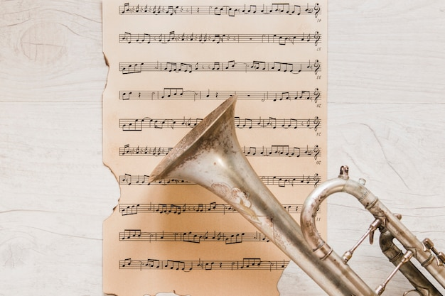 Trumpet on old page of sheet music