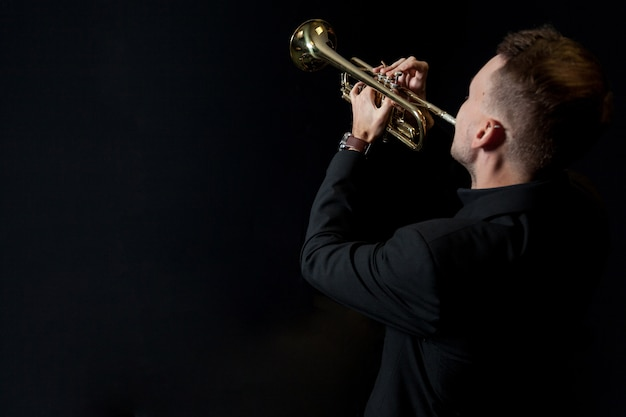 Trumpet player on black background