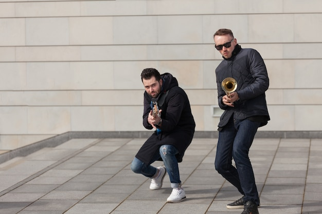 Trumpet player and guitarist fooling