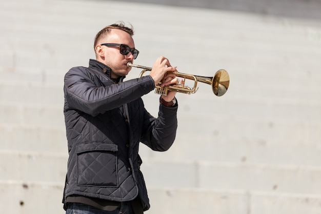 Trumpet player rehearsing outdoors