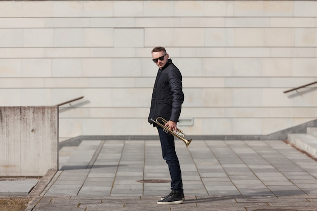 Trumpet player in urban environment
