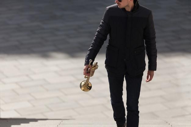 Trumpet player walking upstairs