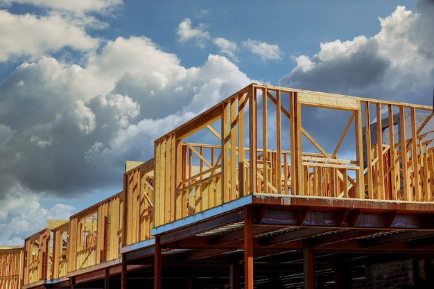 Truss, joist, beam new house under construction exterior framing with timber framing