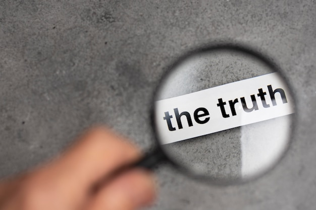 Truth concept arrangement with a magnifier
