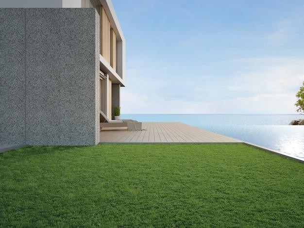 Терраса возле бассейна и зеленого сада в современном пляжном домике