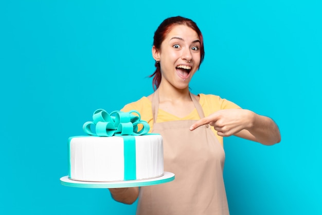 Tty bakery employee woman with a birthday cake