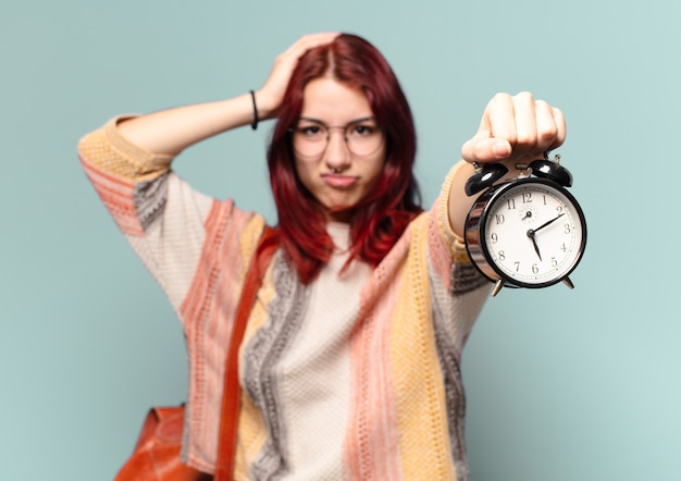 Tty student woman with an alarm clock