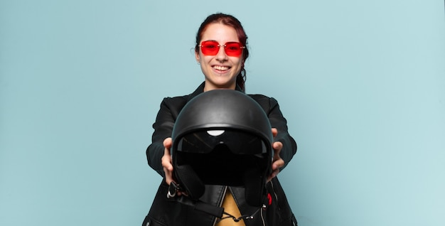 Tty woman motorbike rider with a safety helmet