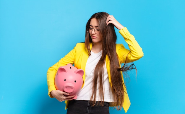 Tty woman with a piggy bank