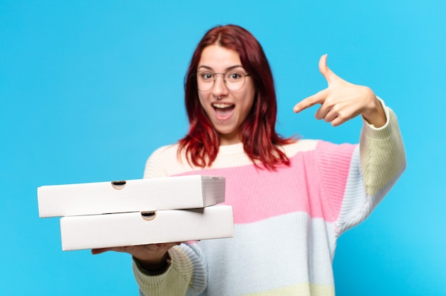 Tty woman with take away pizza boxes
