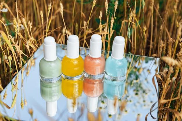 Tubes of colored nail polish close-up