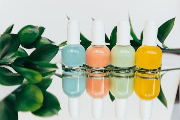 Tubes of colored nail polish closeup