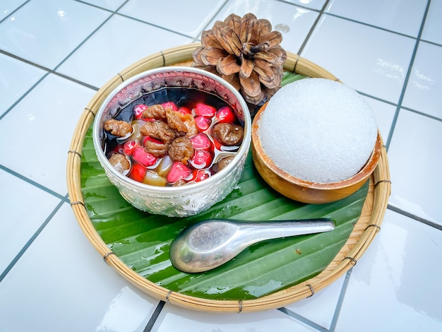Tubtim krob in thai language, thai dessert water chestnuts in coconut milk and ice