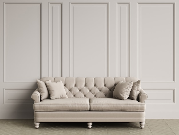 Tufted ivory color sofa in classic interior with copy space